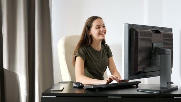 Thumbnail for Teenage Girl Typing on Her Computer in the Bedroom