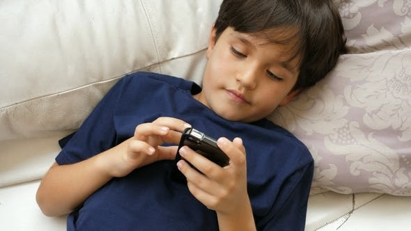 Thumbnail for Boy Playing with Cell Phone