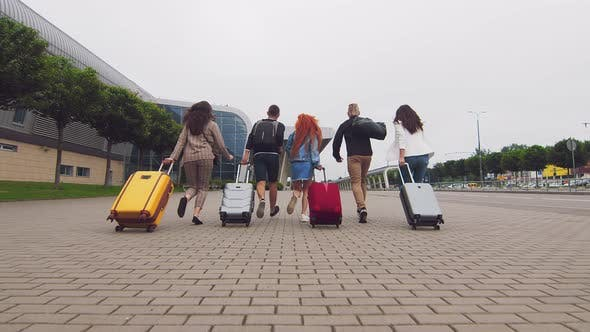 Thumbnail for Tourists Travelers Run To the Airport Terminal. Flight Delay. Young People Run with Luggage To the