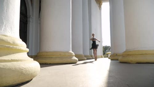 Pirouette of Slim Elegant Caucasian Ballerina Spinning on Tiptoes To Camera in Sunlight