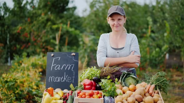 Thumbnail for Portrait of a Farmer Woman Selling Vegetables at a Farmers Market