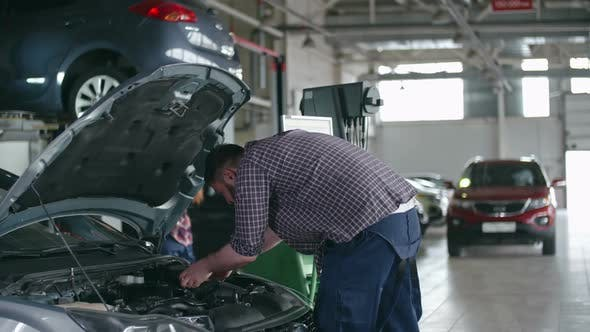 Thumbnail for Experienced Technicians Fixing Car