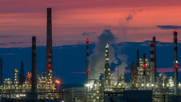 Cover Image for Oil and Gas Refinery Factory and Smoke Stack at Twilight