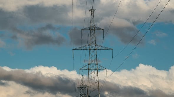 Cover Image for High Voltage Electricity Tower Pylons and Transmission Power Lines on the Cloudy Sky Background.