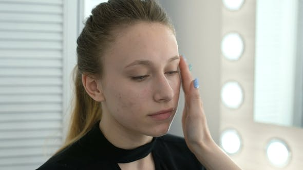 Cosmetologist Puts Oil on the Skin of a Girl with a Problematic Skin
