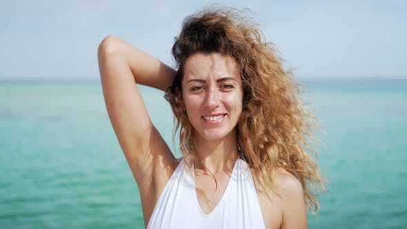 Thumbnail for Portrait of Beautiful Young Woman. Blowing in Wind on Tropical Beach
