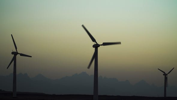Thumbnail for Beautiful Windmill Turbines Harnessing Clean, Green, Wind Energy Silhouetted in the Sunset Sky with