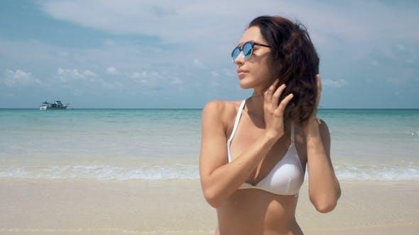 Thumbnail for Woman in White Bikini Refreshing at the Beach