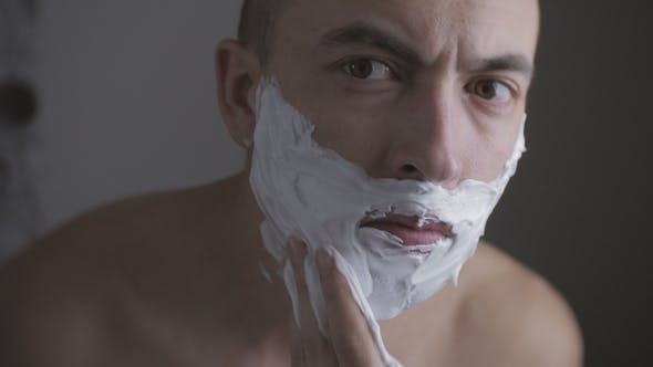 Thumbnail for Adult Man Shaving with Foam and Manual Razer