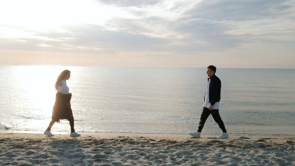 Thumbnail for Young Trendy Man and Woman, People on Sand Beach, Happy Married Adult Couple Having Fun, Playing