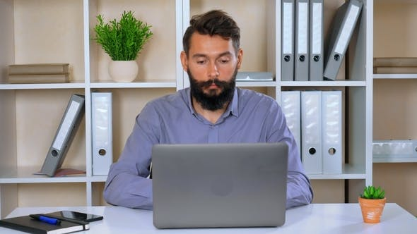 Thumbnail for Employer Looking Focused on Screen Computer