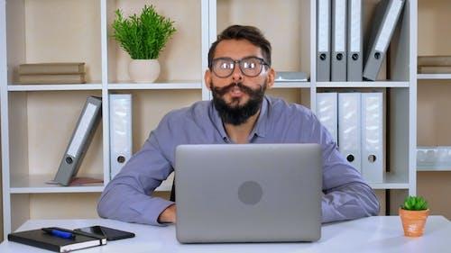 Employee Amusingly Using Computer