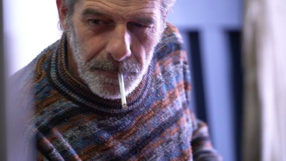 Thumbnail for Elderly Man Smoking a Cigarette