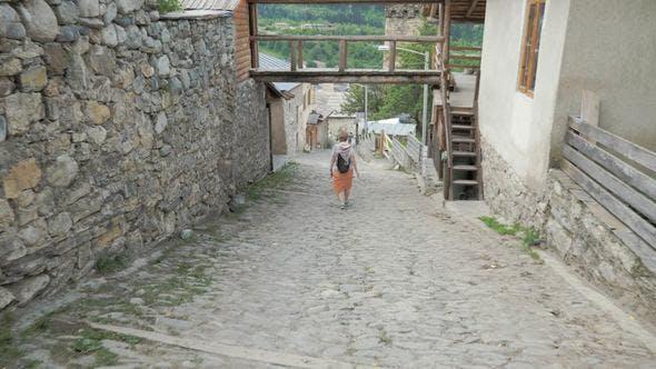 Girl Walks in the Old City Mestia, Georgia
