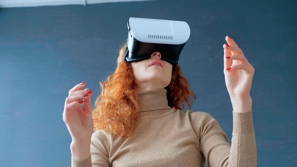 Thumbnail for Redhead Woman with Virtual Reality Glasses