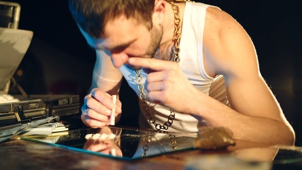 Thumbnail for Young Man Sniffs Cocaine on a Mirror with a Roll of Banknotes. Abuse of Drugs. Criminal Business