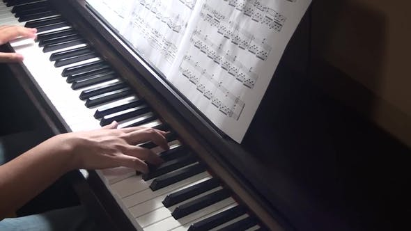 Thumbnail for Teen Hands Playing the Piano with Classical Sheet on the Music Deck