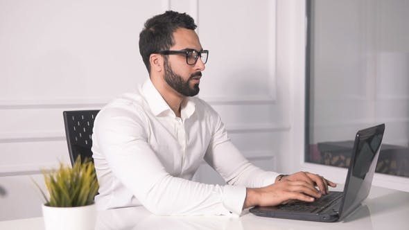 Cover Image for Tired Businessman Before Laptop