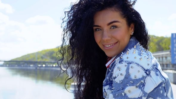 Cover Image for Happy Beautiful Brunette in Jeans Jacket with Thorns
