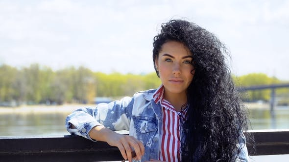 Thumbnail for Beautiful Curly Brunette at River Background