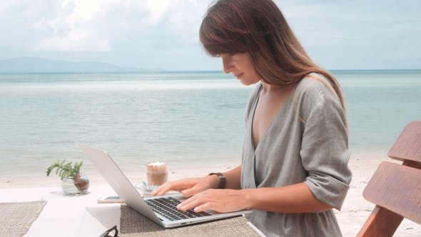 Thumbnail for Happy Young Woman Works on Laptop in Outdoors Cafe