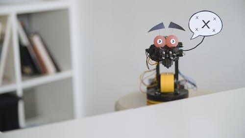Funny Robot with Placeholder Say Cloud. Experiment with Intelligent Manipulator. Industrial Robot