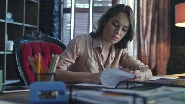 Thumbnail for Focused Business Woman Writing Finance Report in Home Office