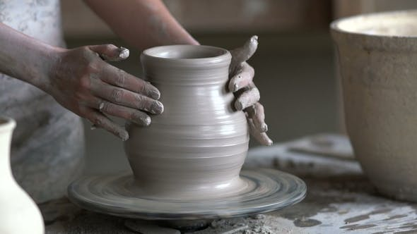 Thumbnail for Potter Sculpts a Vase on a Potter's Wheel