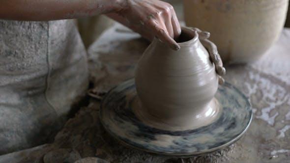 Thumbnail for Potter Sculpts a Vase on a Potter's Wheel