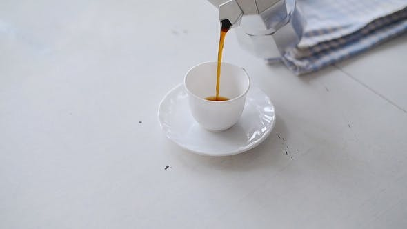 Thumbnail for Hand Pouring Coffee From a Moka Pot. White Table
