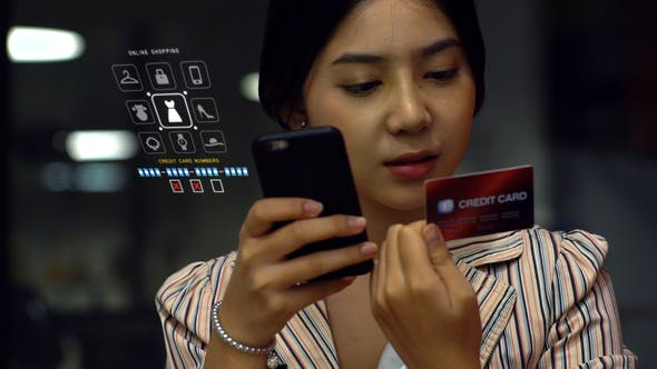 Thumbnail for Asian Teenage Girl Using a Mobile Phone to Buy Online Products