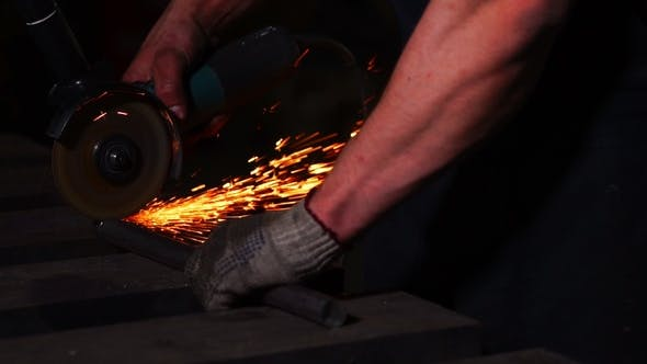Cover Image for Man Working with Grinder while Sparks Fly