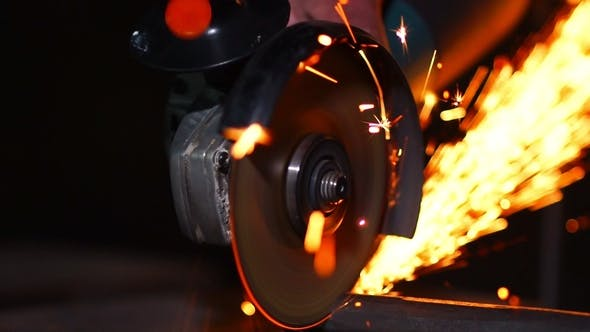 Thumbnail for Man Working with Grinder while Sparks Fly