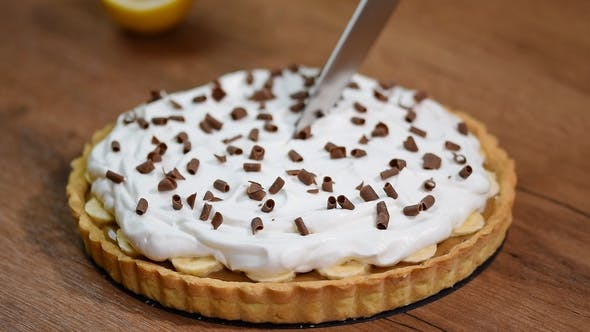 Thumbnail for Banoffee Pie with Bananas, Whipped Cream, Chocolate. Cutting Piece Banoffee Pie