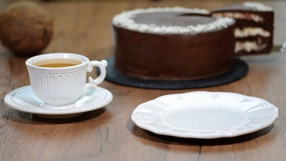 Thumbnail for Put a Piece of Chocolate Coconut Cake in a Plate