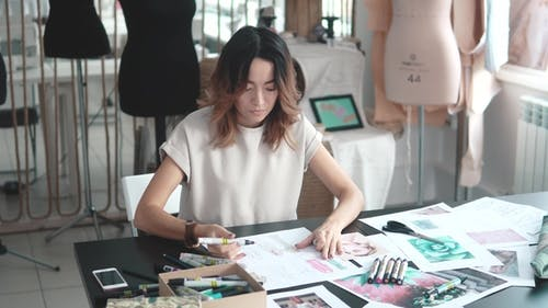 Designer Draw Sketches in the Studio. Workspace Designer. Fashion Designer Works in the Atelier