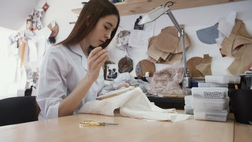 Fashion Tailor Is Embroidering a Picture of a Flower Leaf on the Fabric