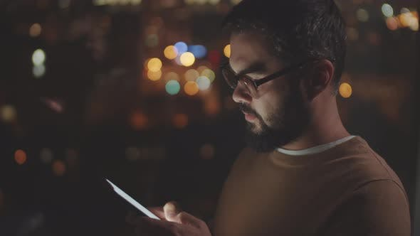 Cover Image for Businessman Using Smartphone in Office at Night