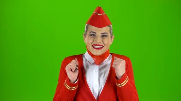 Thumbnail for Girl Dressed in Red Rejoices in Victory. Green Screen