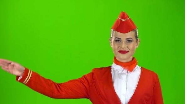 Thumbnail for Stewardess in a Red Suit Salutes the Pilot. Green Screen