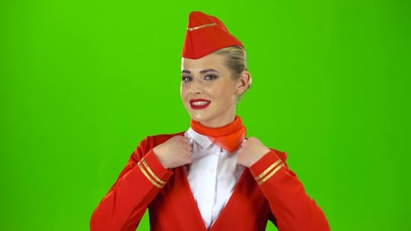 Thumbnail for Girl Is Straightening the Cap. Green Screen