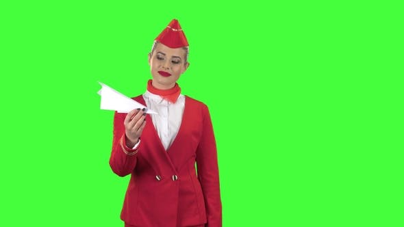 Thumbnail for Girl Is Launching a Paper Airplane. Green Screen