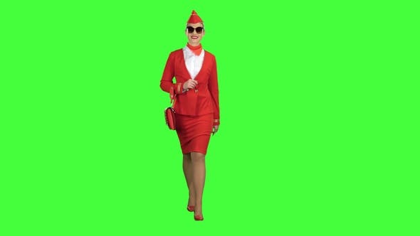 Thumbnail for Girl in Sunglasses Is Walking. Green Screen