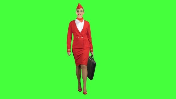 Thumbnail for Stewardess Walks with a Briefcase in Her Hands. Green Screen