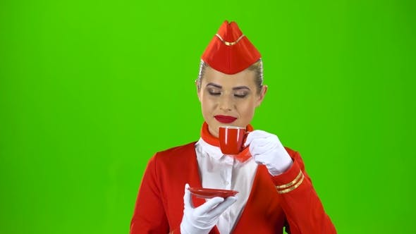Thumbnail for Stewardess in Gloves Drinks Coffee with a Red Mug. Green Screen