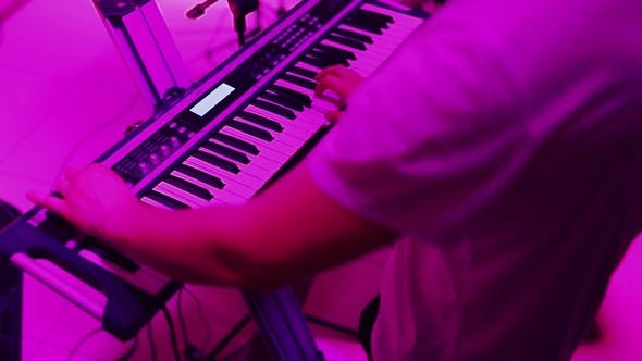 Thumbnail for Hands Playing the Piano. Fingers on the Piano, Colors Lights