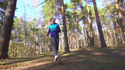 Girl Falls on a Run in the Forest, Sports Injury