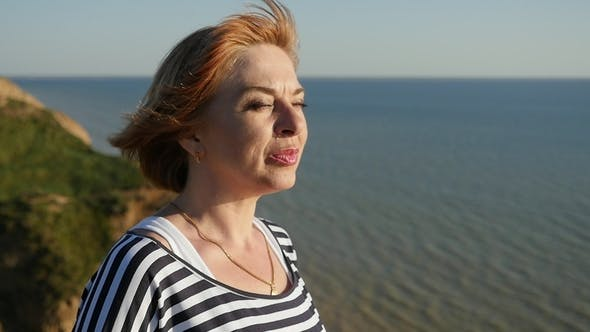 Thumbnail for Happy Woman Stands on the Black Sea Shore and Smiles in Summer