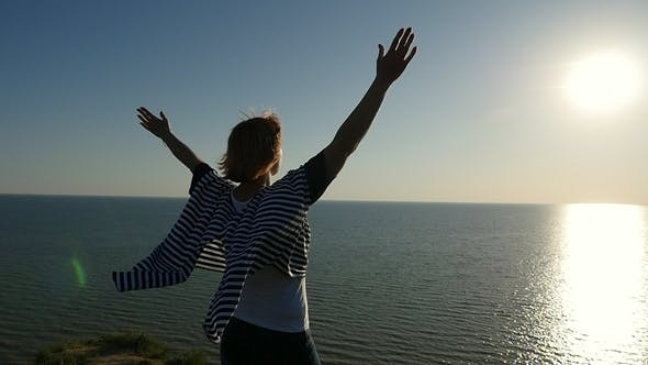 Thumbnail for Happy Woman Raises Her Hands Up on the Black Sea Coast at Sunset