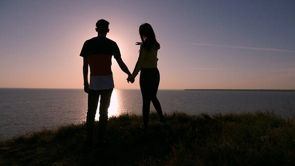 Thumbnail for A Pair in Love Enjoy a Beautiful Sunset at the Black Sea Shore in Summer